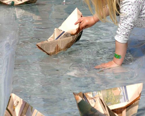 Girl and paperboats